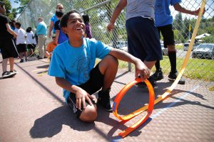 A student explores the physics of roller coasters at the Police Activities League.